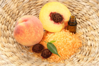 peaches bath with bath salt essential oil and fresh fruits